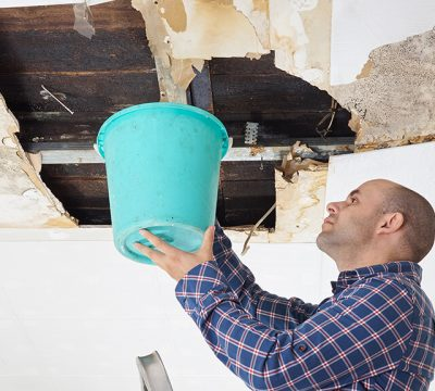 image-man-collecting-water-in-bucket-from-ceiling